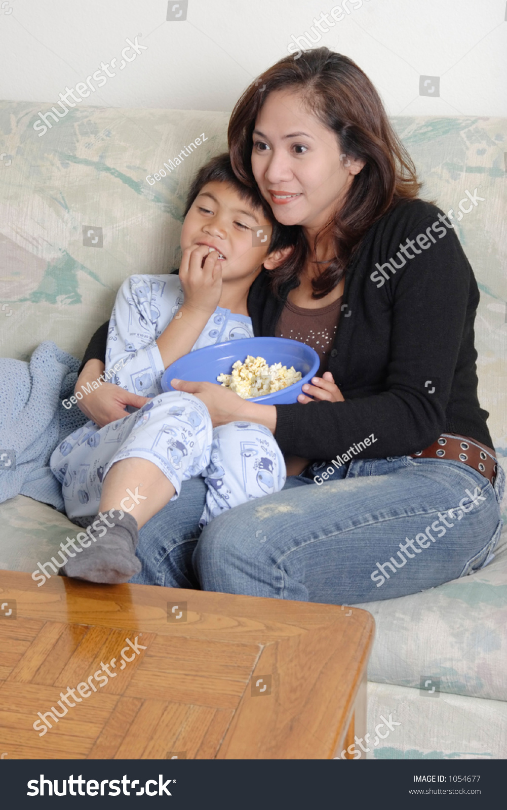 Watch Mom In Bedroom Camera: Mom Son Watching Movie Together Stock Photo 1054677