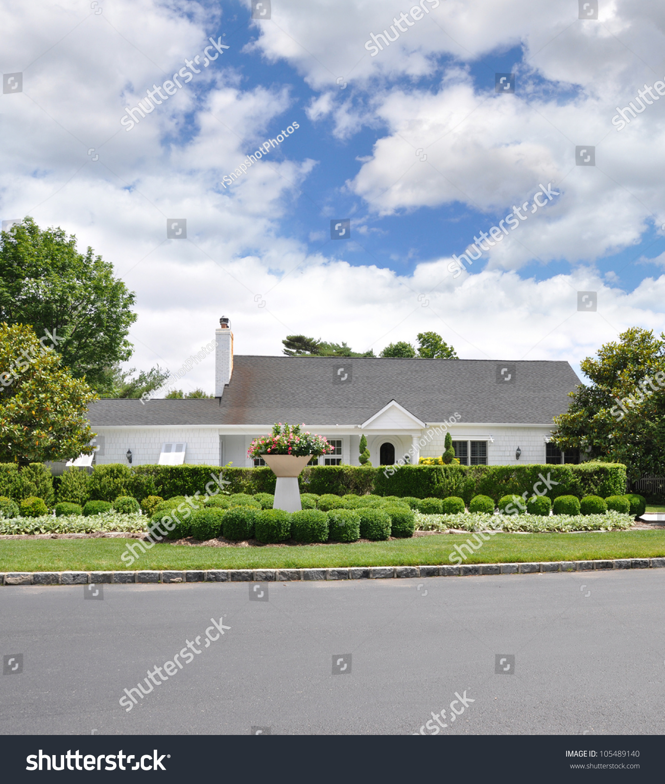 Landscaped Front Yard Suburban Ranch Style Home Blue Cloud