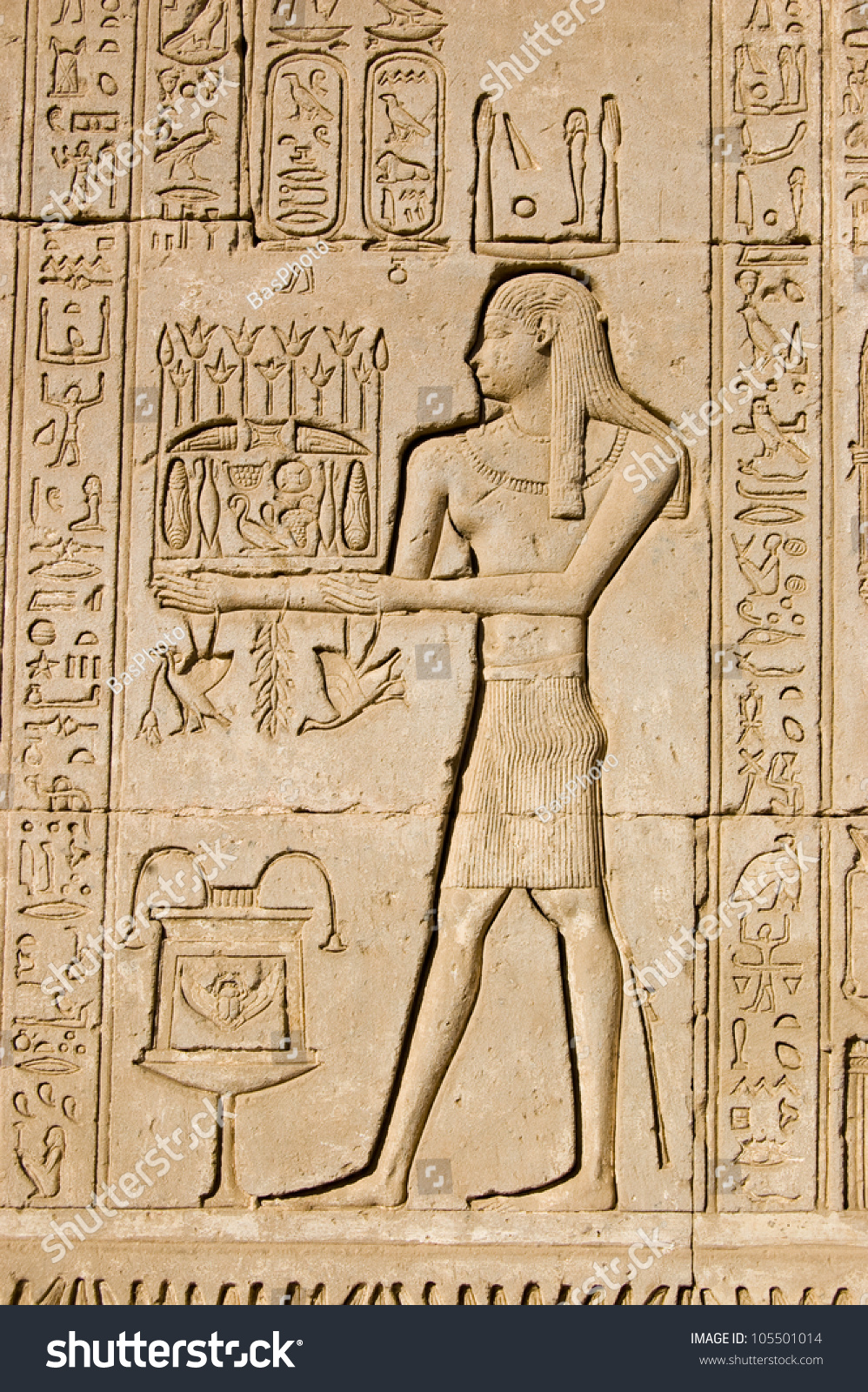 Ancient egyptian bas relief carving of a priest making an