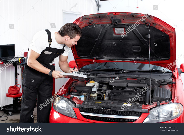 Professional Mechanic Working In Auto Repair Service ...