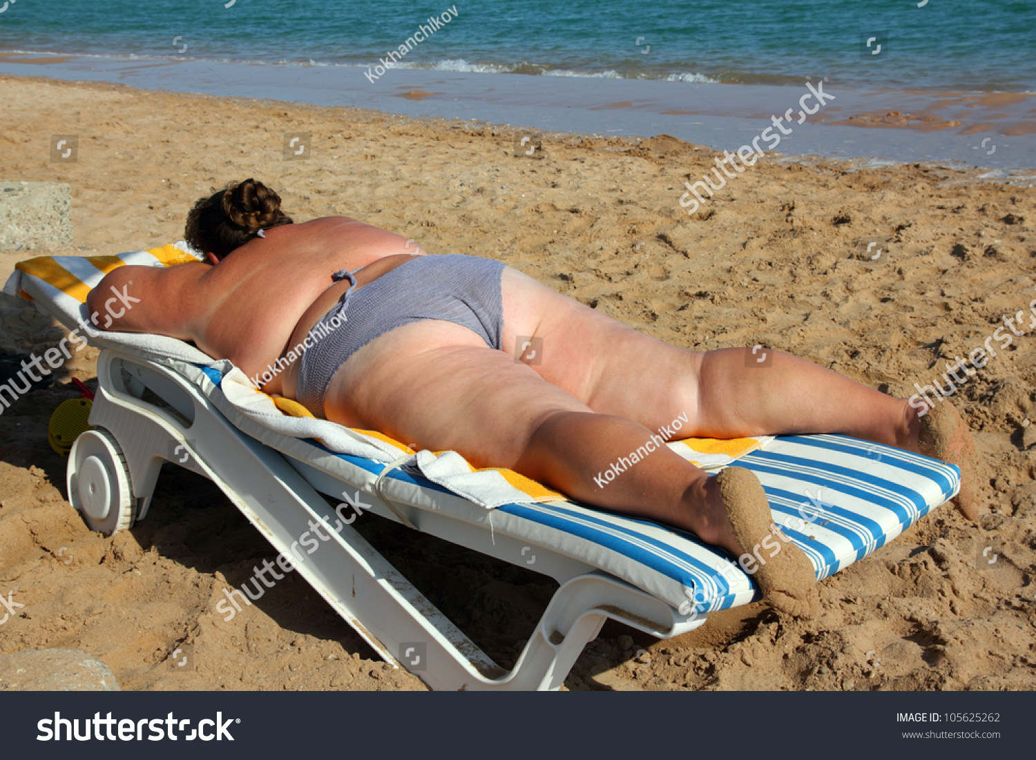 stock-photo-vacation-overweight-woman-su