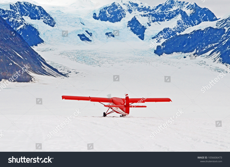 Plane taking off from the glacier in the Don Sheldon Amphitheater, Denali National Park, Alaska.