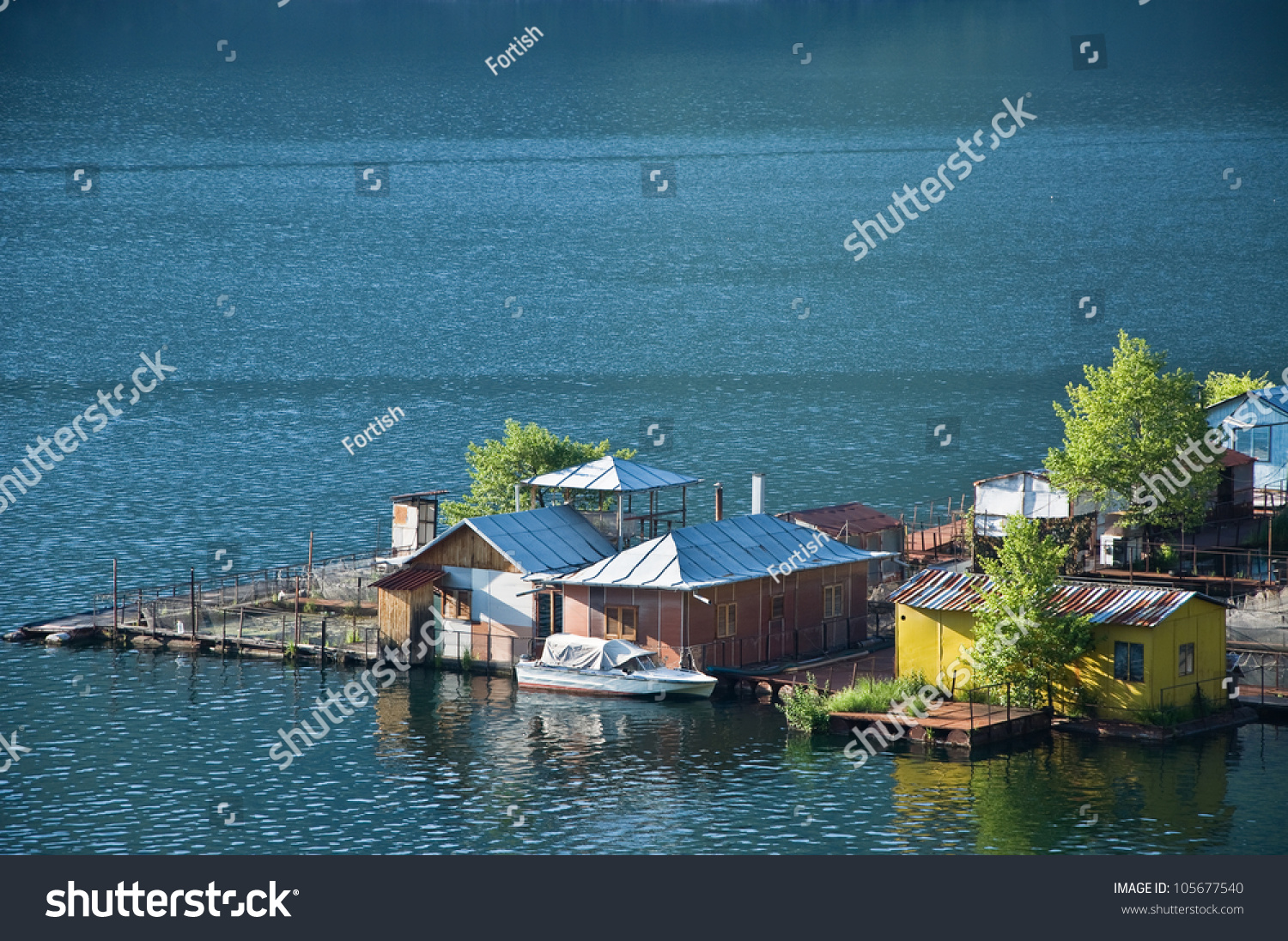 Fish farm located at mountain dam in bulgaria stock photo 105677540 shutterstock - Trout farming business family mountains ...