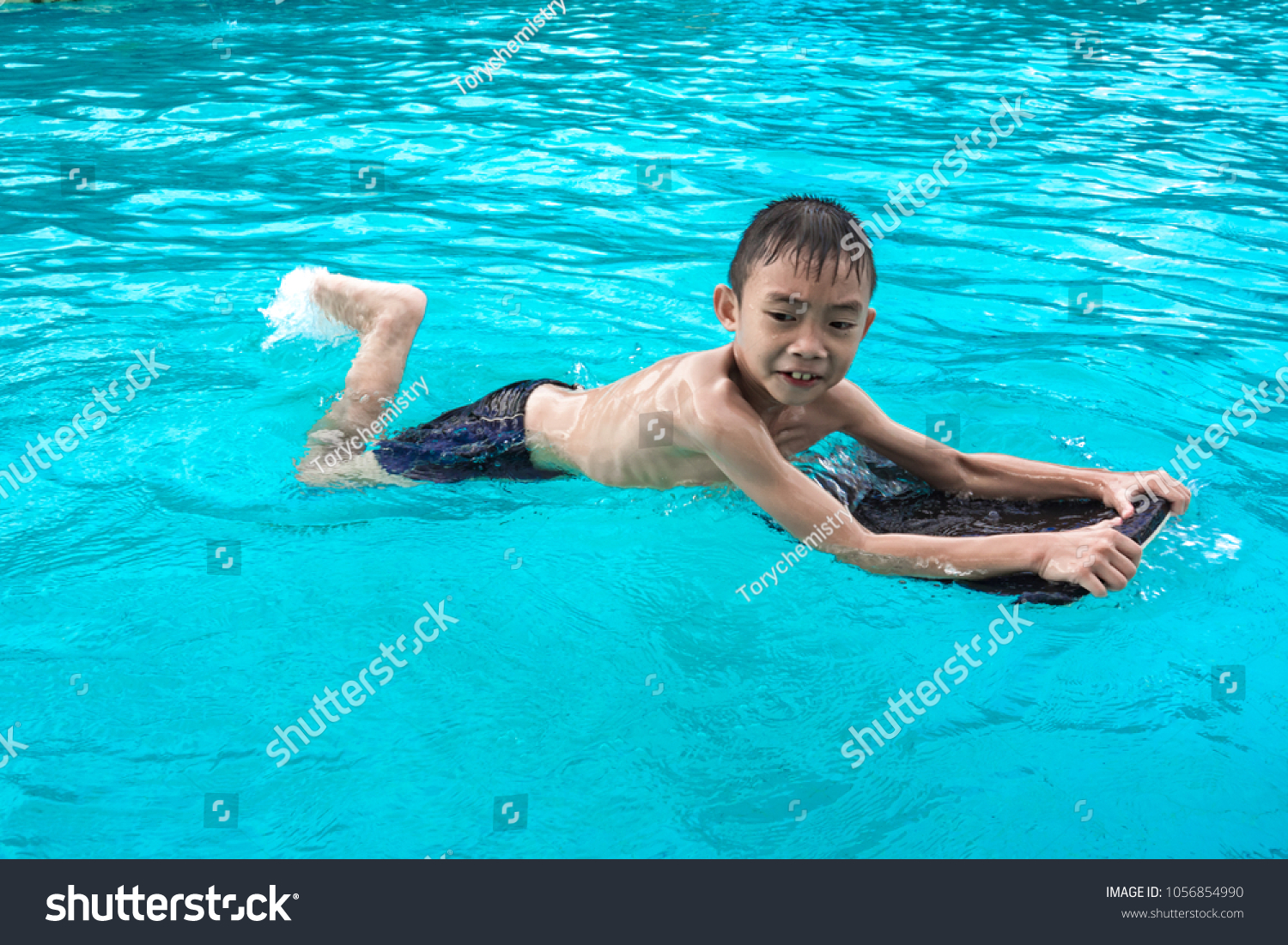 Oriental lad at swimming pool