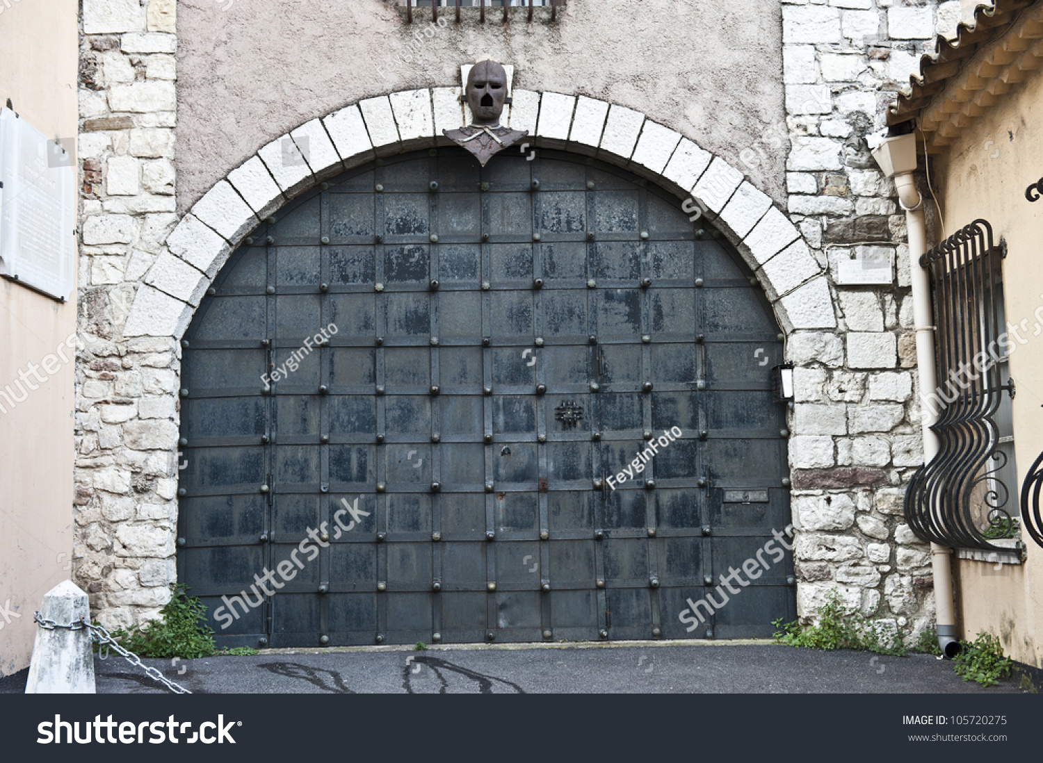 A closeup of a antique, black garage door in Cannes, France. - Closeup Antique Black Garage Door Cannes Stock Photo 105720275