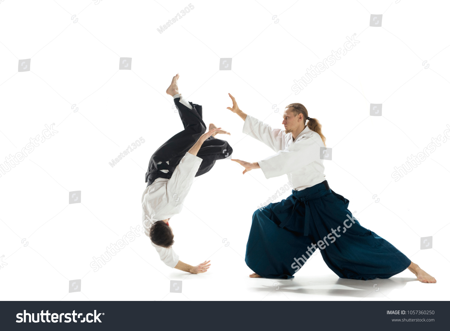 fc92bb0664419 Men fighting at Aikido training in martial arts school. Healthy lifestyle  and sports concept.