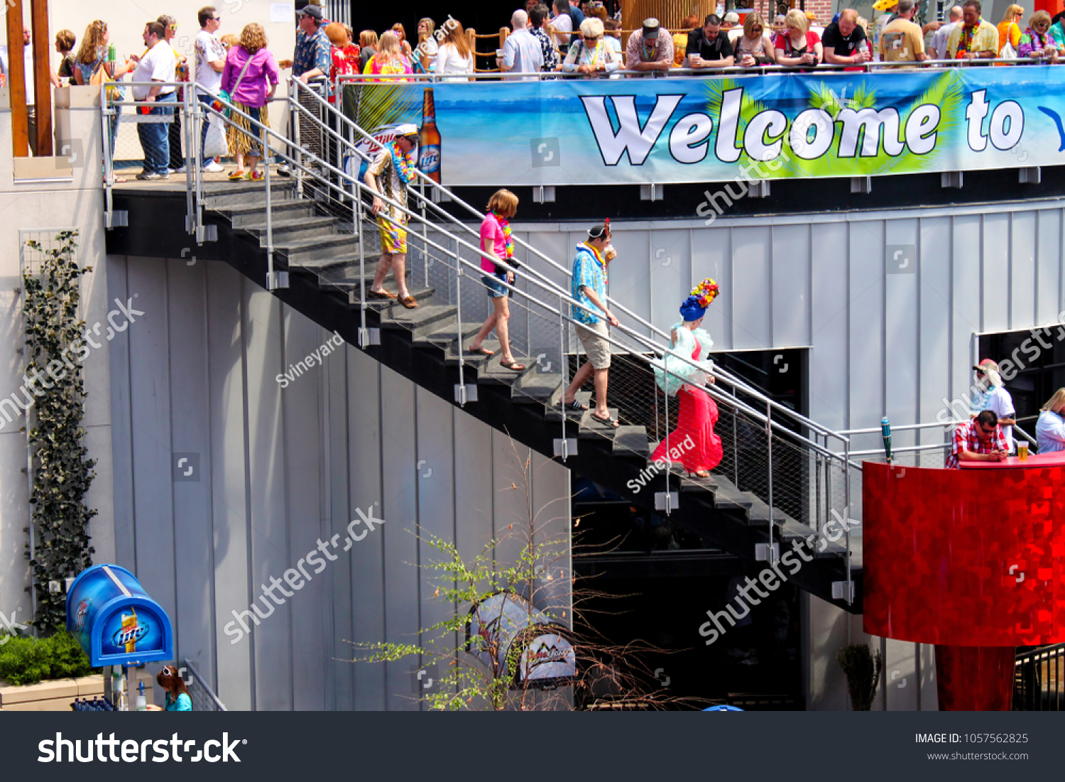 People In Tropical Costumes Descending Open Air Stairs At Pre Concert Party In  Power And