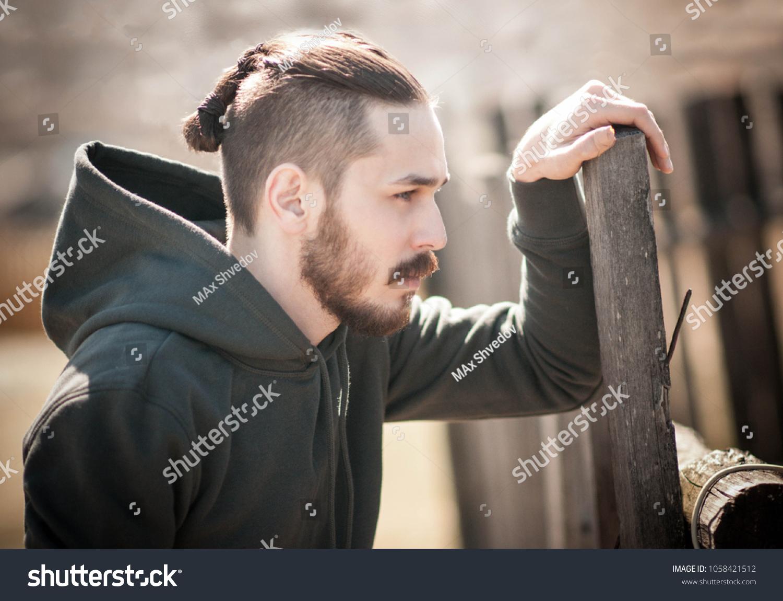 Man Viking Style Haircut Staring Off Stock Photo Edit Now