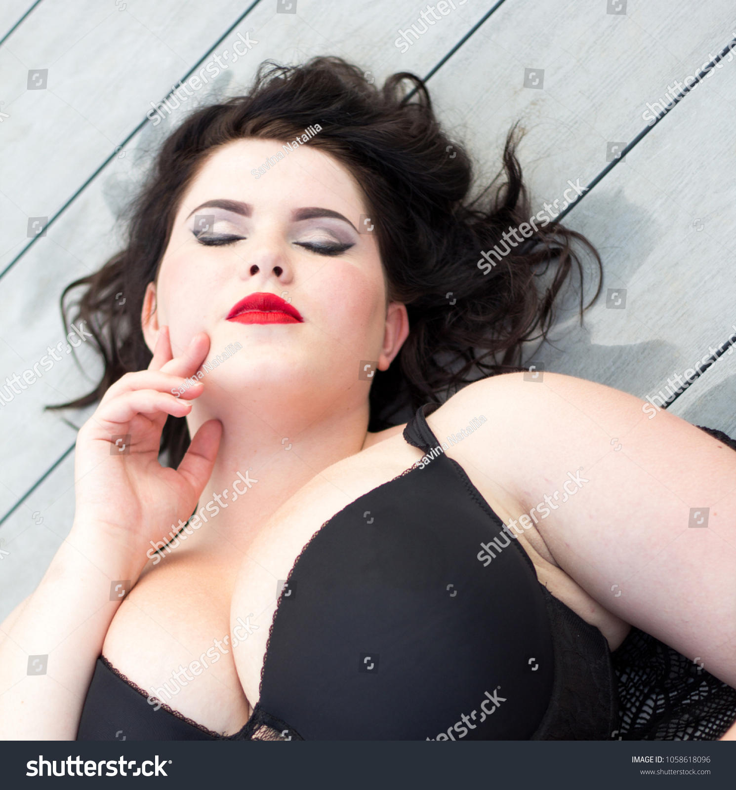 Young beautiful busty curvy plus size model with big breast in black bra,  xxl woman
