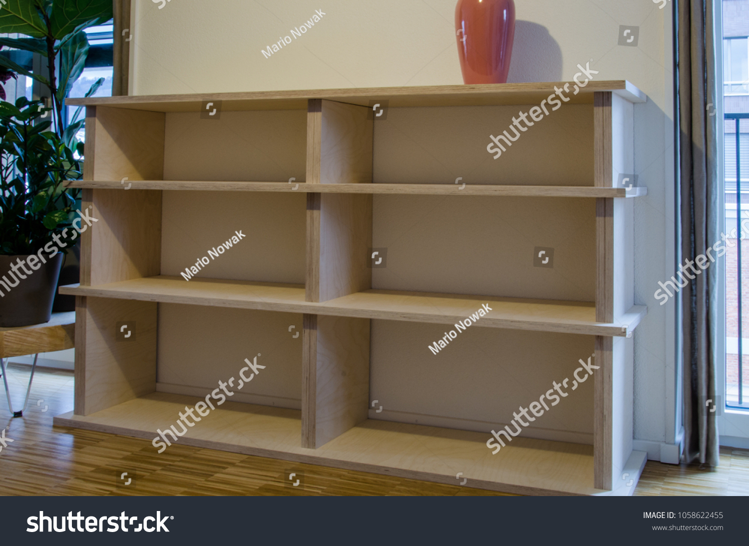 Empty Bookshelf Made Of Wood In Flat At Home