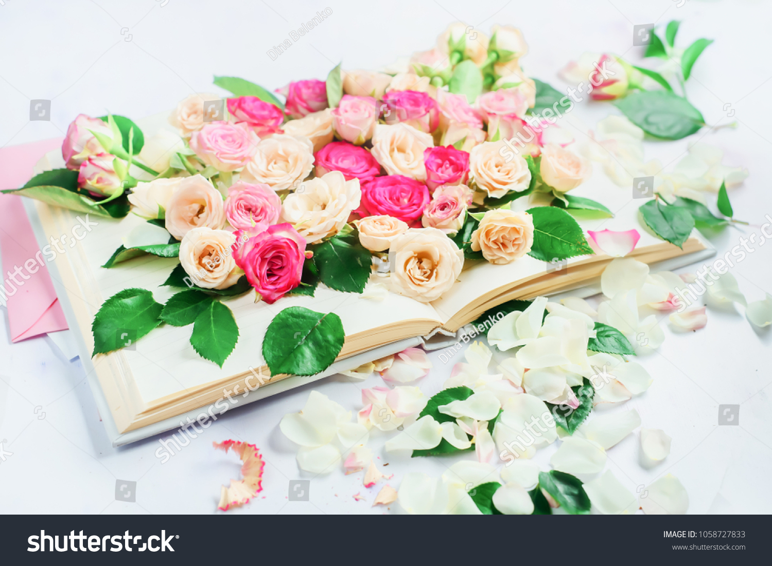 Open Book Flowers Rose Petals On Stock Photo (Edit Now) 1058727833