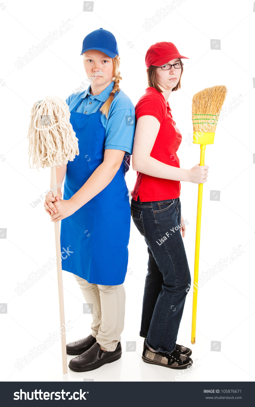two teenage girls dressed in uniforms for their first jobs save to a lightbox