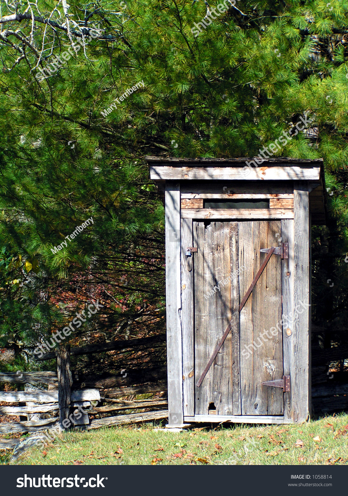 On outhouse swinging the gate