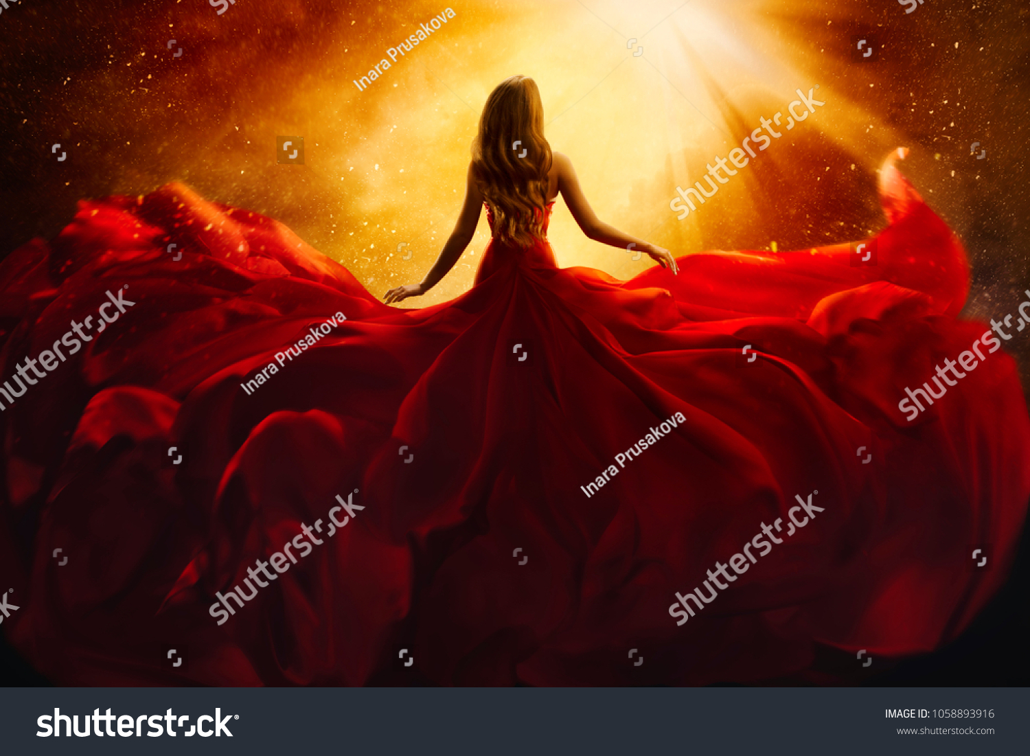 Fashion Model Back Side in Red Flying Dress, Woman Rear View, Gown Fabric Fly on Wind, Beautiful Girl Looking to Light #1058893916