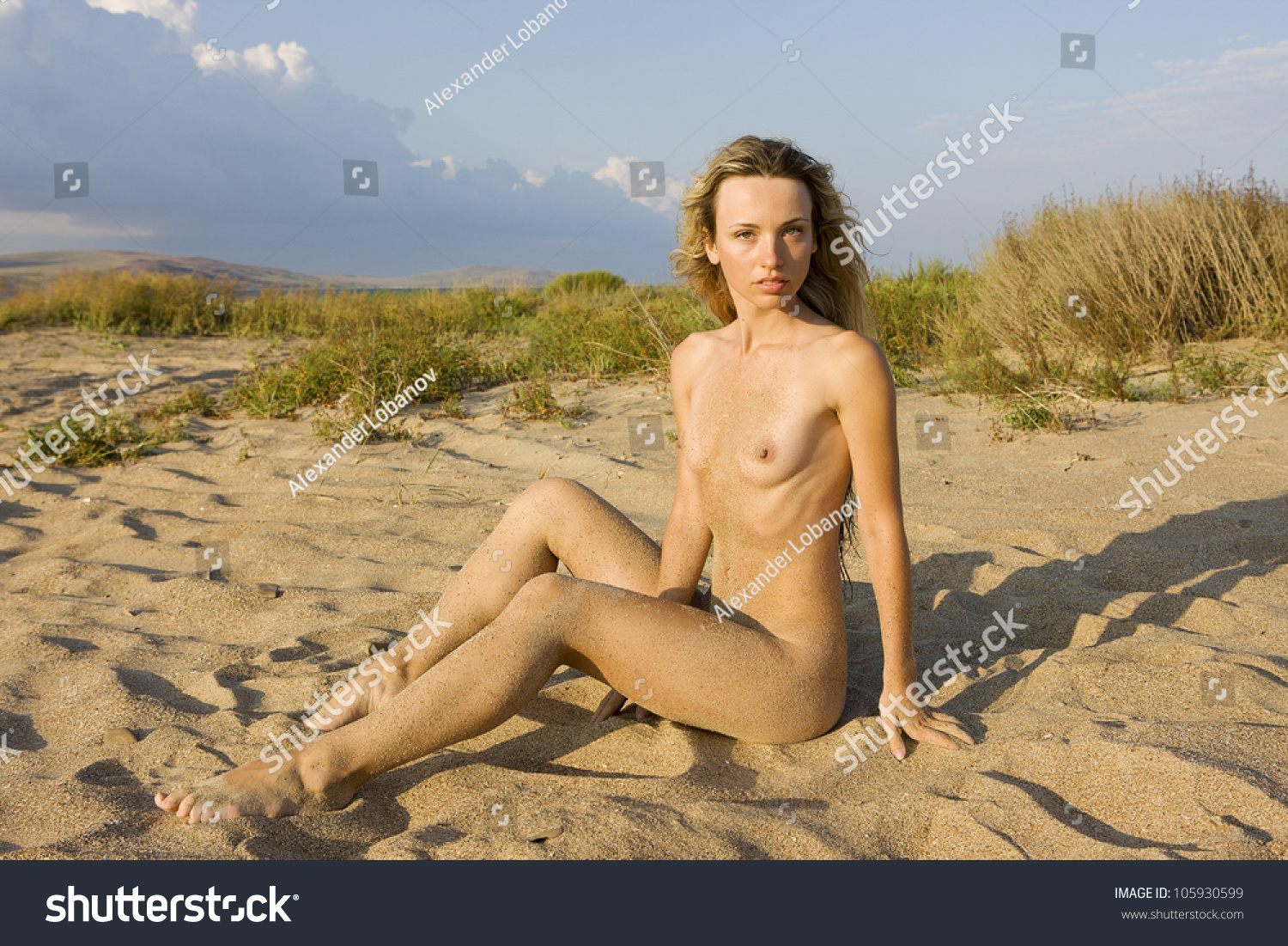 sand naked Nude girl. Young naked woman in the sand.