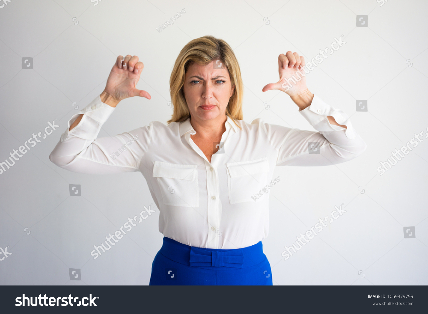 angry mature caucasian woman formal blouse stock photo (royalty free