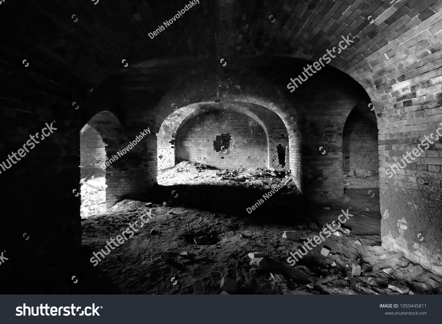 Black and white photograph of the interior of an old ruined brick building mystical picture