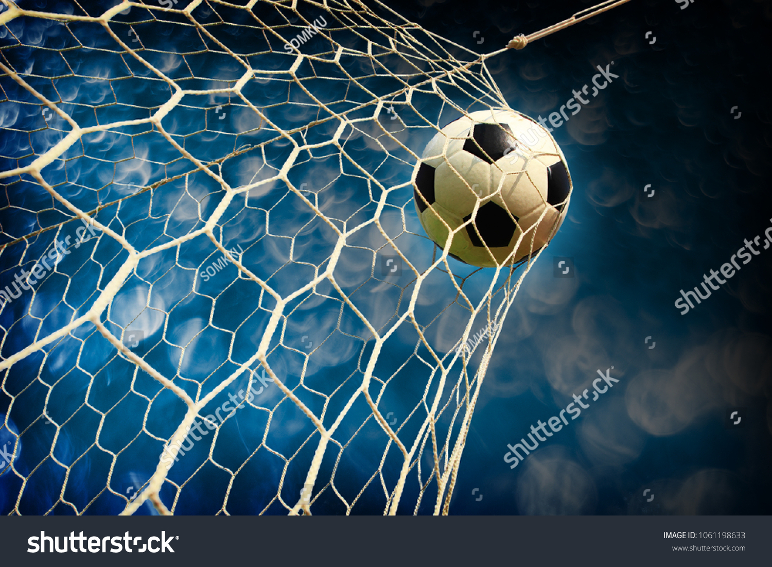 soccer field with a ball in goal #1061198633