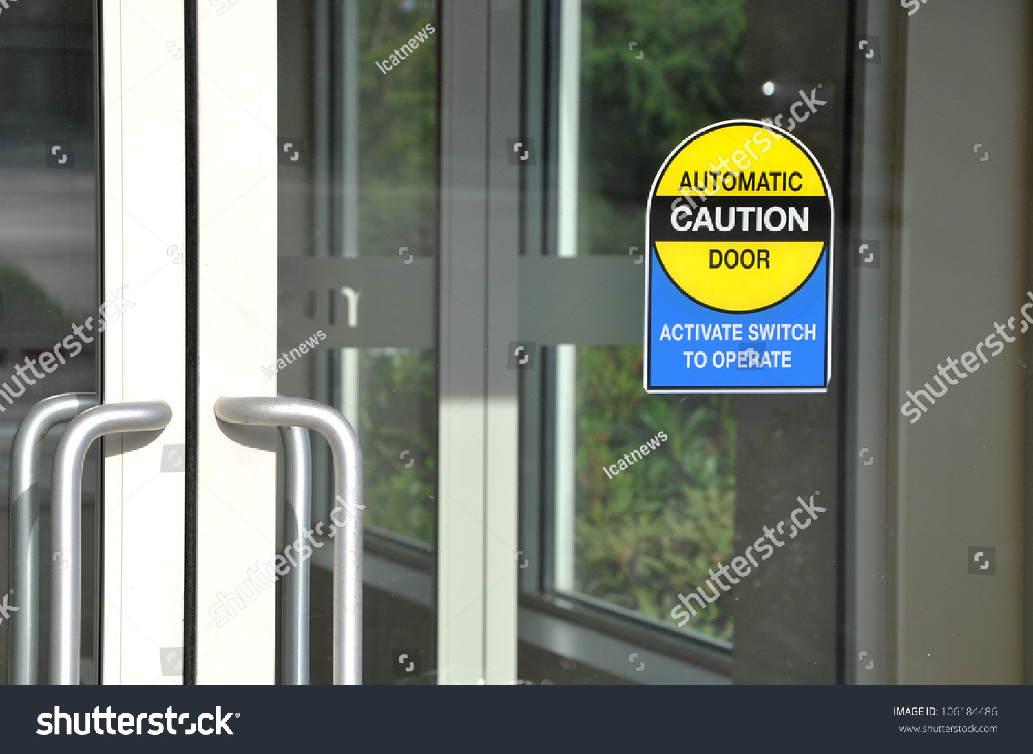 Automatic caution door sign stock photo