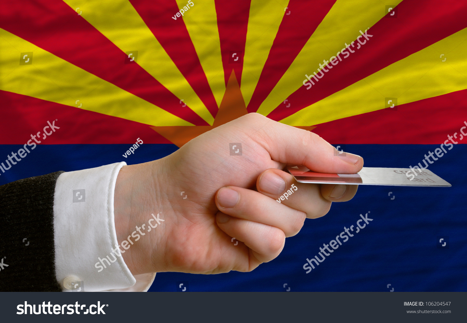 Man Stretching Out Credit Card To Buy Goods In Front Ofplete Wavy National  Flag Of
