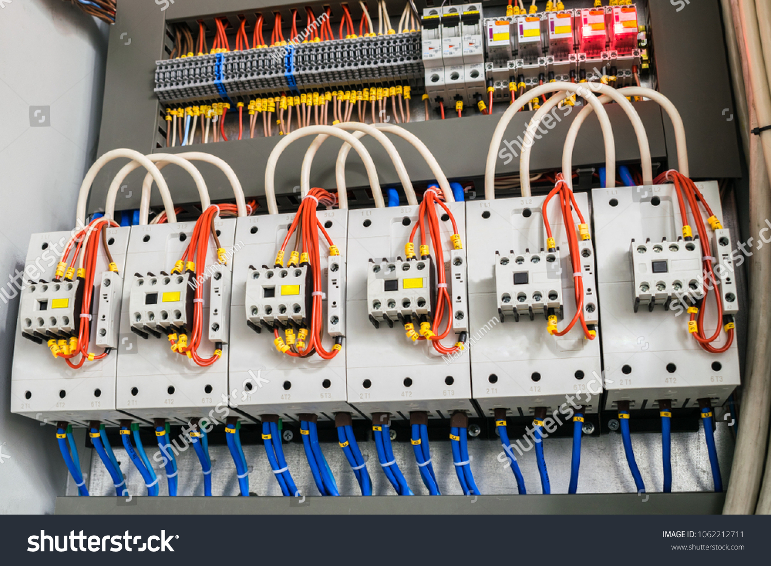 A modern open fuse box contains a lot of automata, connectors, relays, and