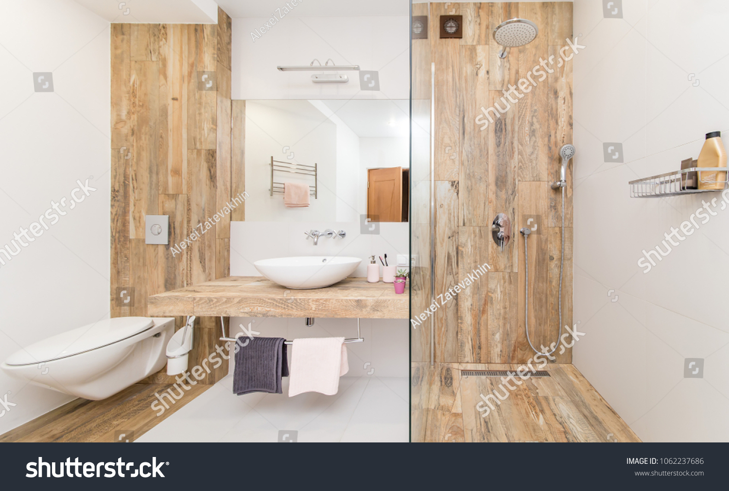 Modern Bathroom Interior Combined With Toilet. Shower Room And Toilet Are  Covered With Tiles In