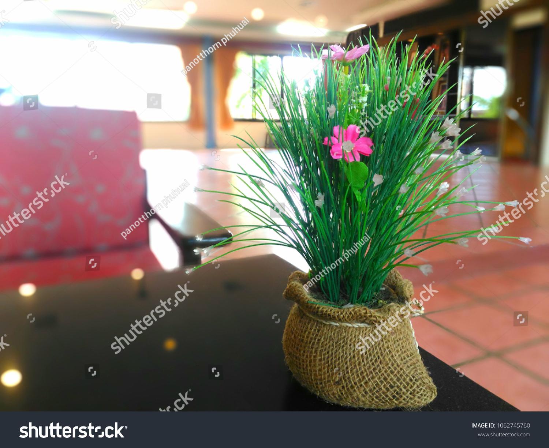 Beautiful fake flowers blur background stock photo 1062745760 beautiful fake flowers with blur background izmirmasajfo Choice Image