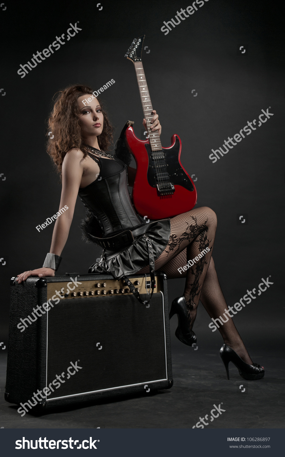 Sexy woman with red guitar