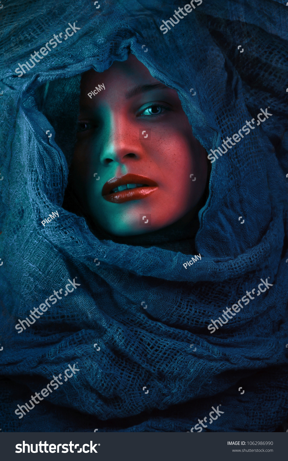 e2a3b8e383d Woman Covers Her Face Blue Cloth Stock Photo (Edit Now) 1062986990 ...