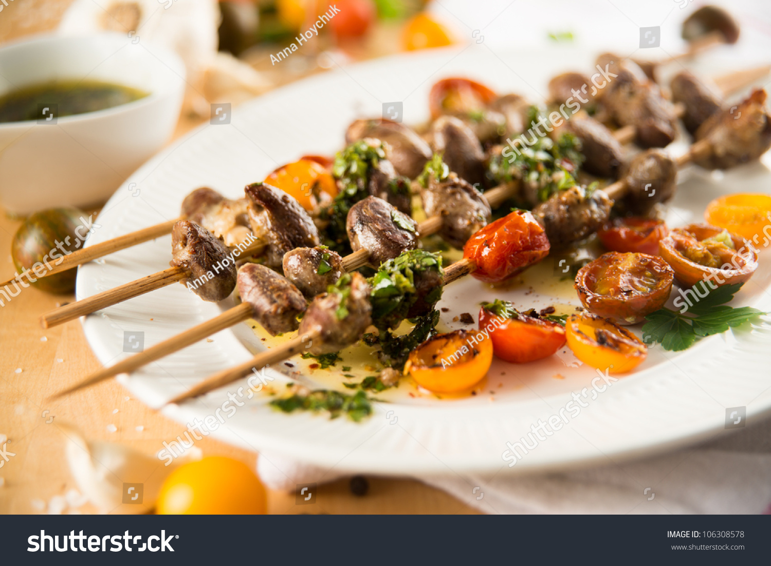 Chicken Hearts Grilled With Heirloom Cherry Tomatoes On Wooden Skewers ...