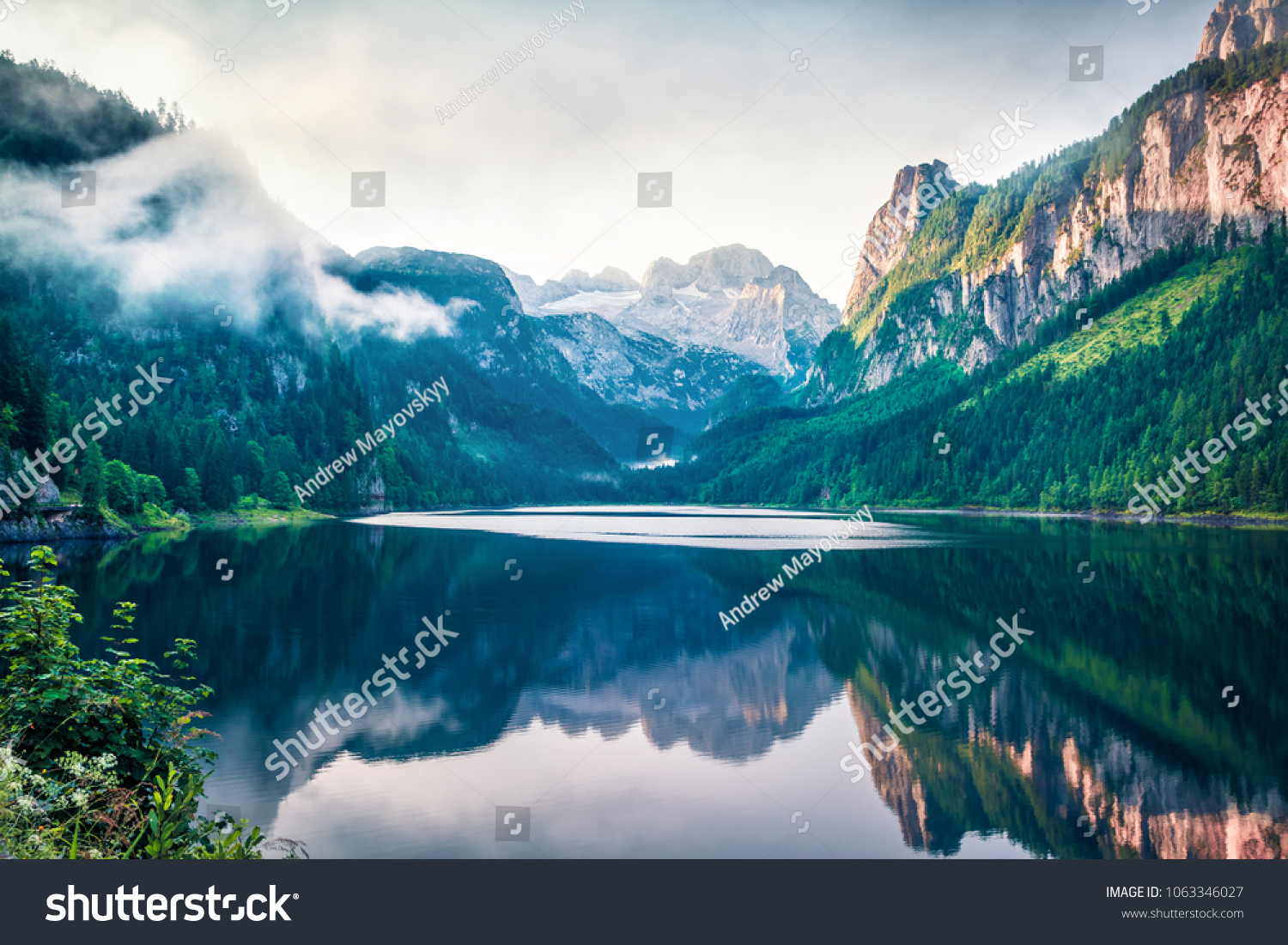 Colorful summer scene of Vorderer ( Gosausee ) lake with Dachstein glacier on background. Amazing morning view of Austrian Alps, Upper Austria, Europe. Orton Effect.
