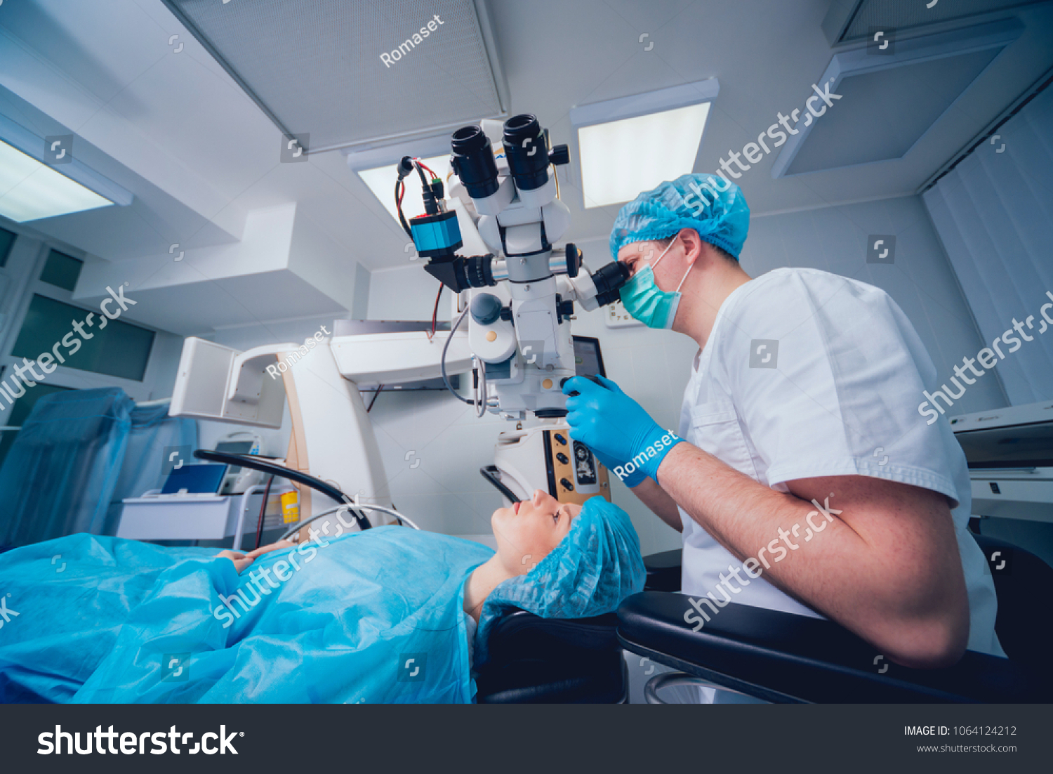c6d59fdacbf Eye surgery. A patient and surgeon in the operating room during ophthalmic  surgery. Patient