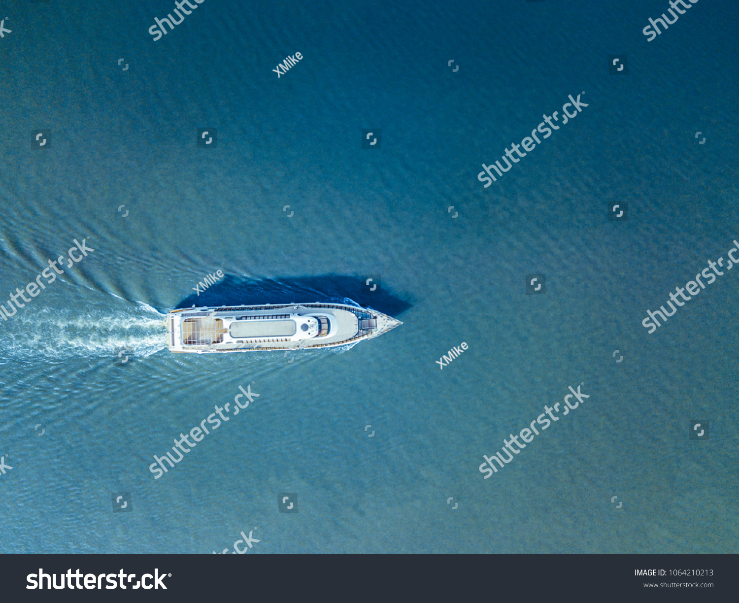 aerial ferry in the sea on a sunny day blue water isolated #1064210213