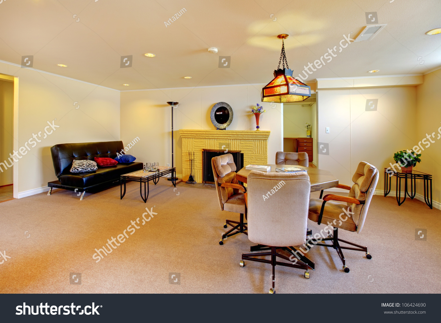 large basement living room with carpet and fireplace stock photo
