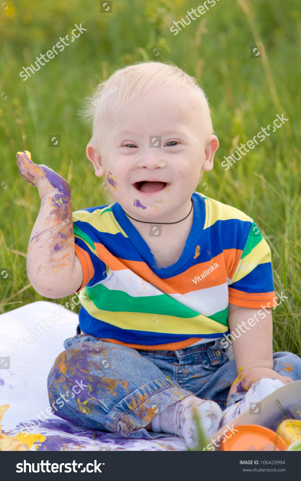 Little Baby Boy With Down Syndrome Painting Finger Paints ...