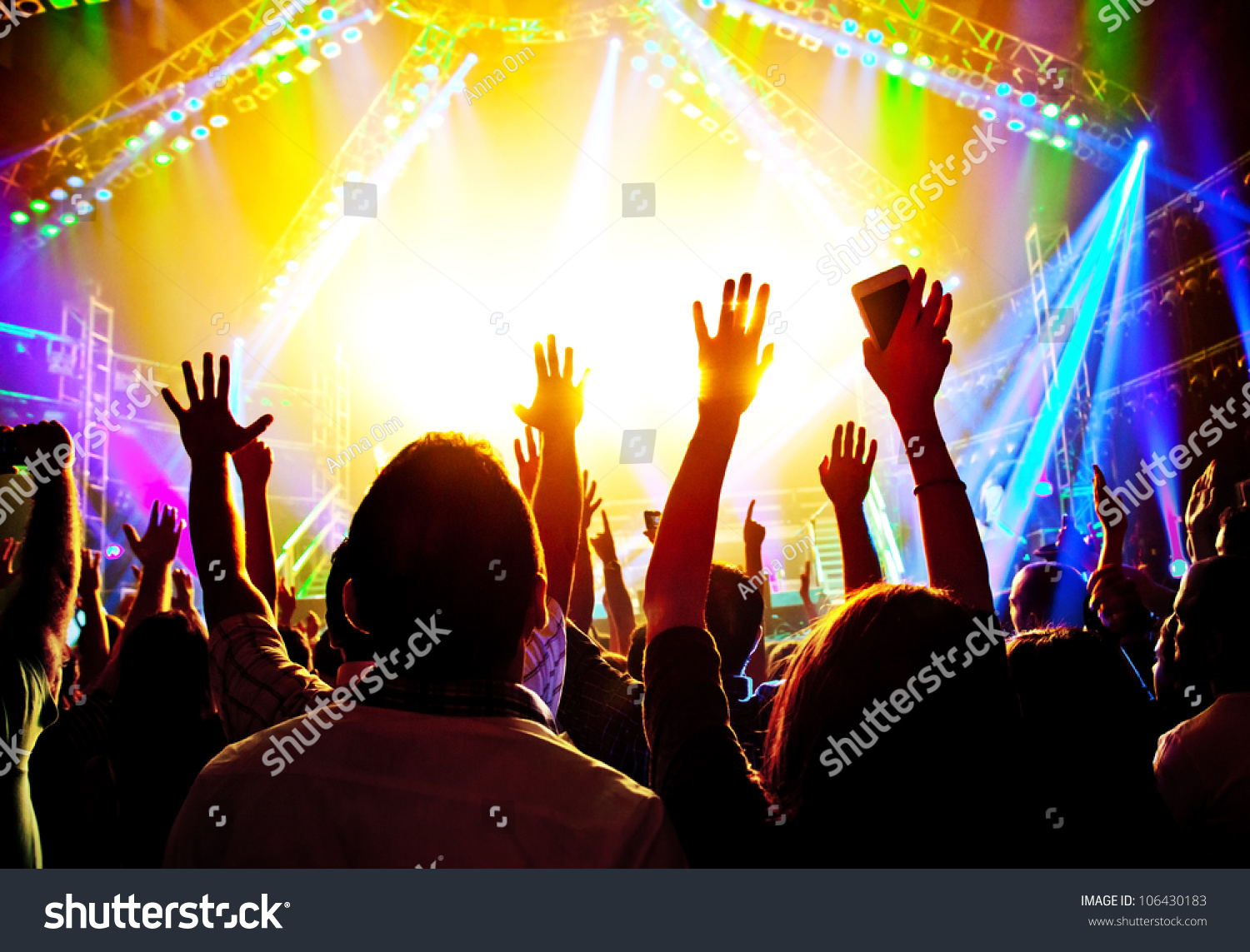 Rock concert happy people silhouettes raise stock photo for Music entertainment