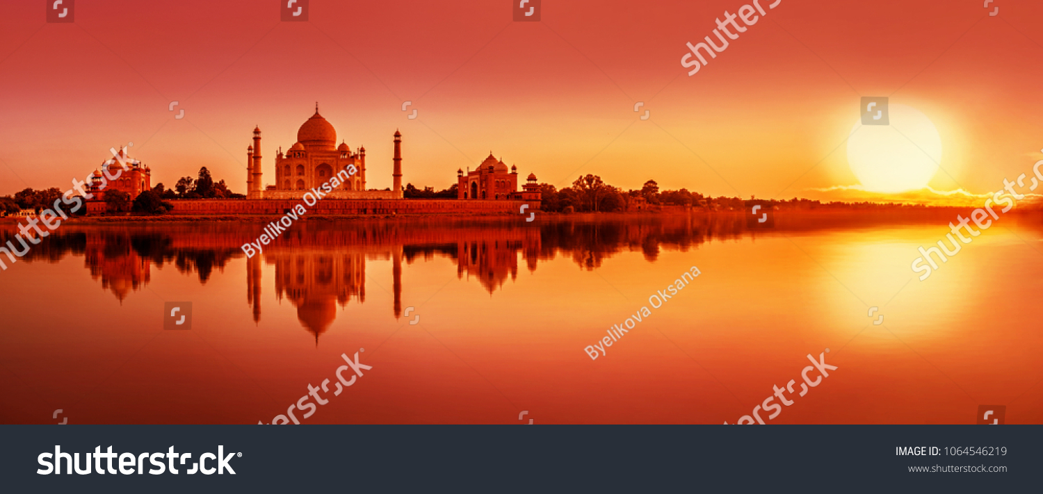 Panoramic view of Taj Mahal during sunset reflected in  Yamuna river, in Agra , Uttar Pradesh, India #1064546219