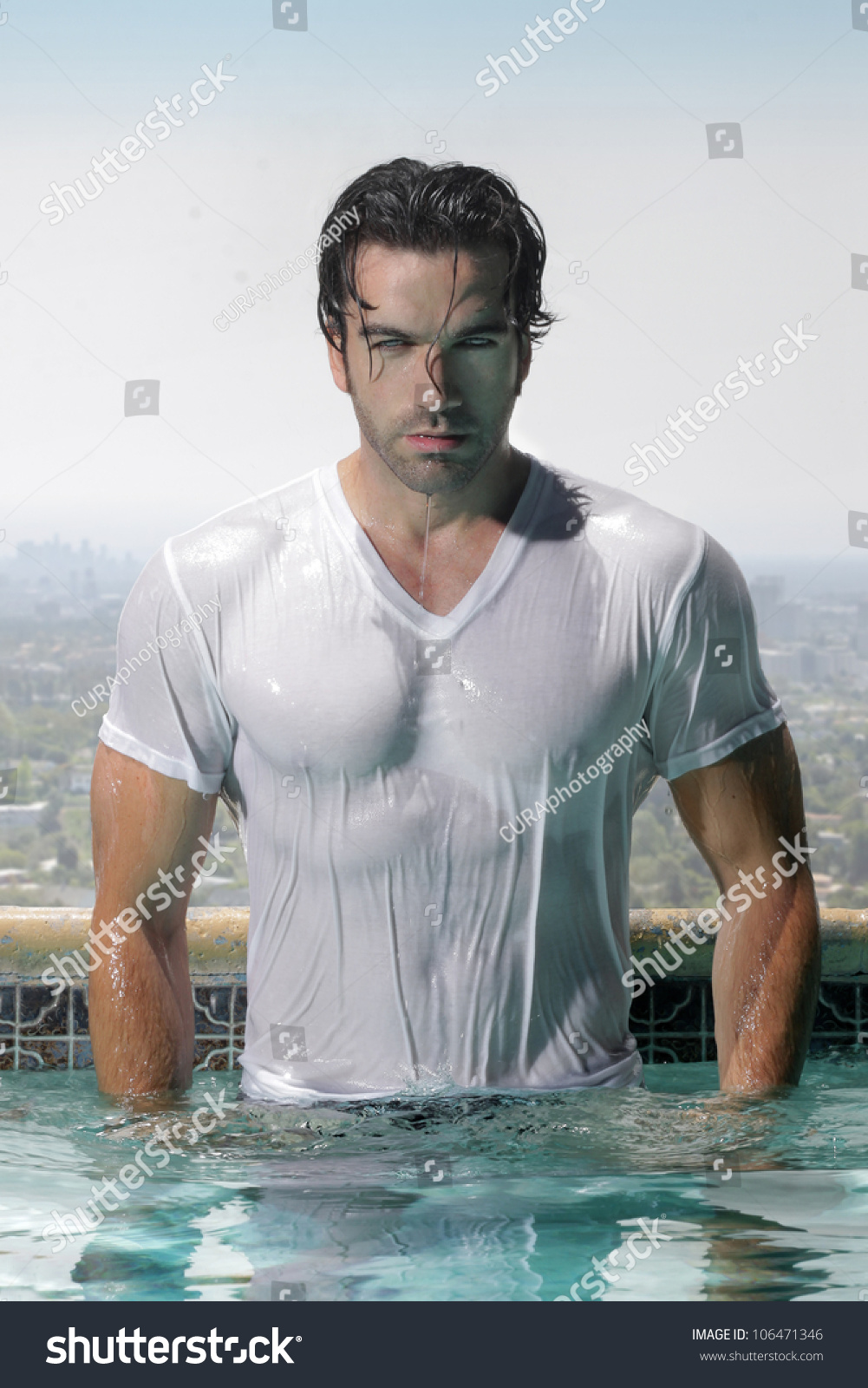 Fashion portrait gorgeous male model soaked stock photo for Wearing t shirt in swimming pool
