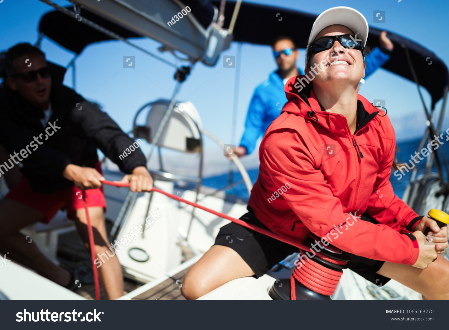 Attractive strong woman sailing with her boat #1065263270