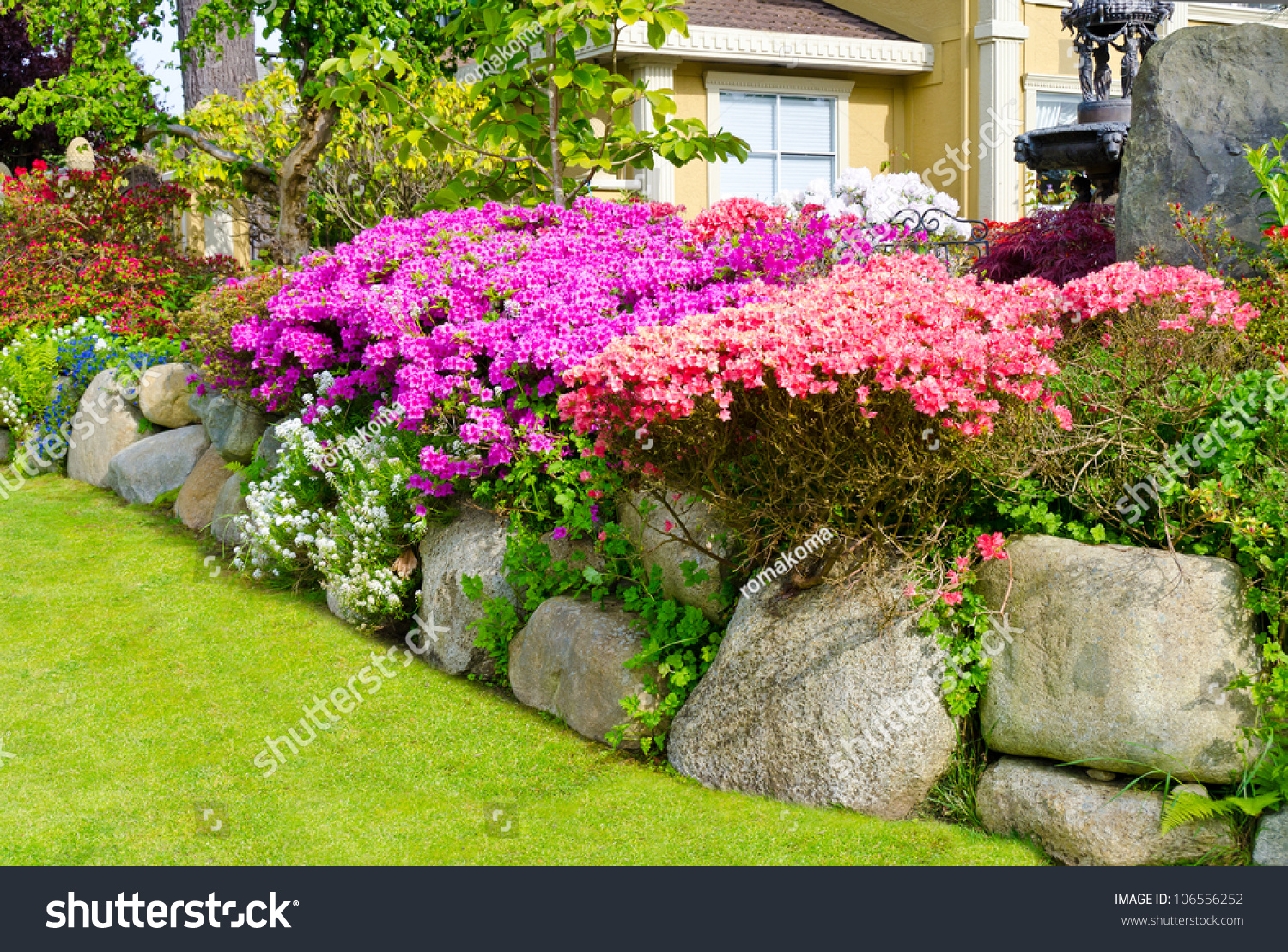 Flowers and stones in front of the house front yard for Plants for the front yard landscape