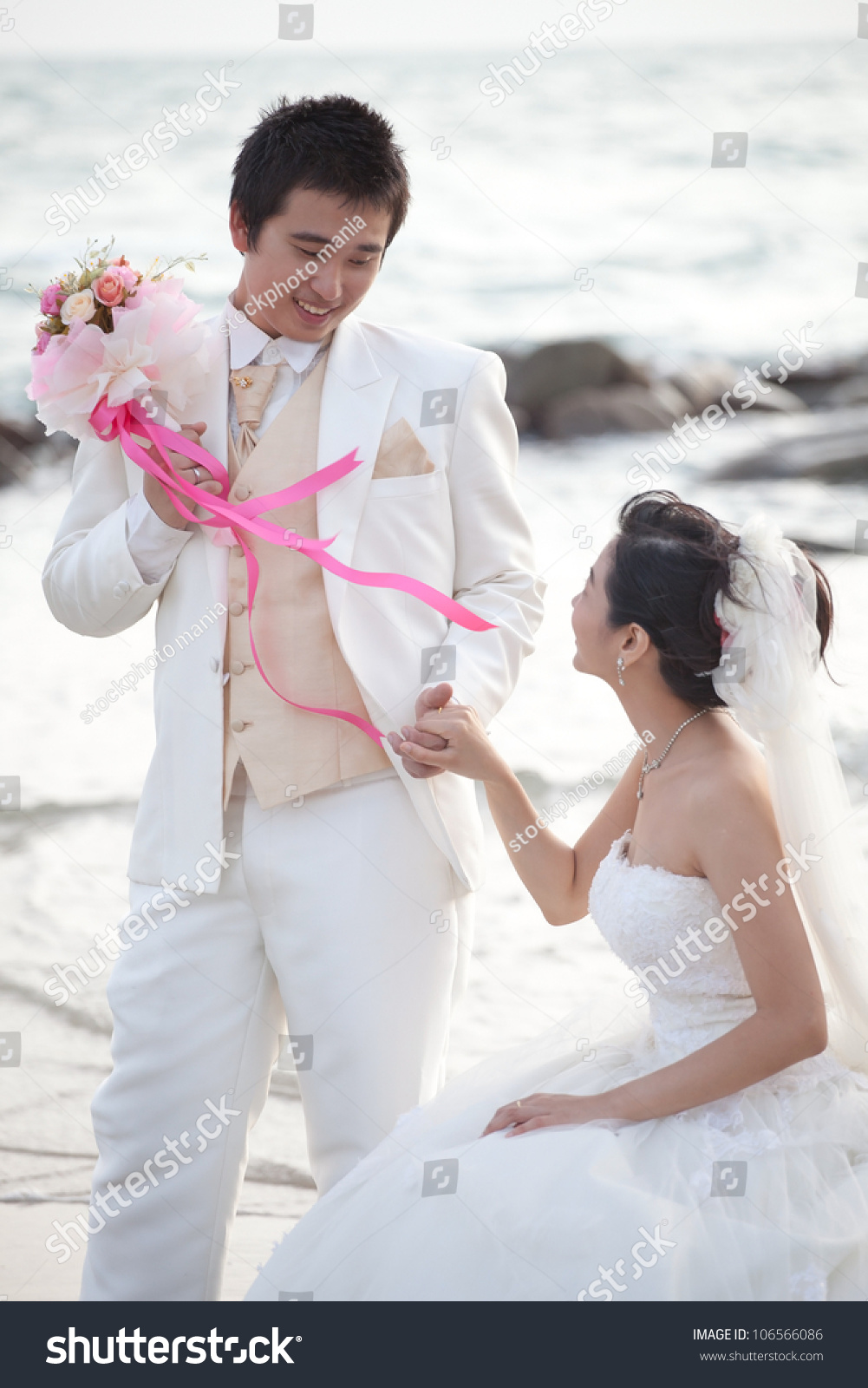 Face Of Asian Groom And Bride With White Wedding Suit Standing On Sea Beach