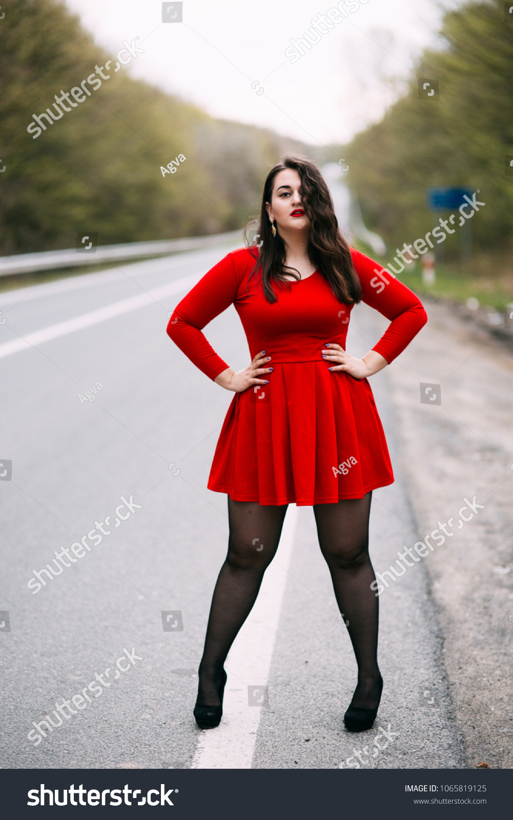 Young Stylish Woman Wearing Red Dress Stock Photo (Edit Now ... 2f39142e49e
