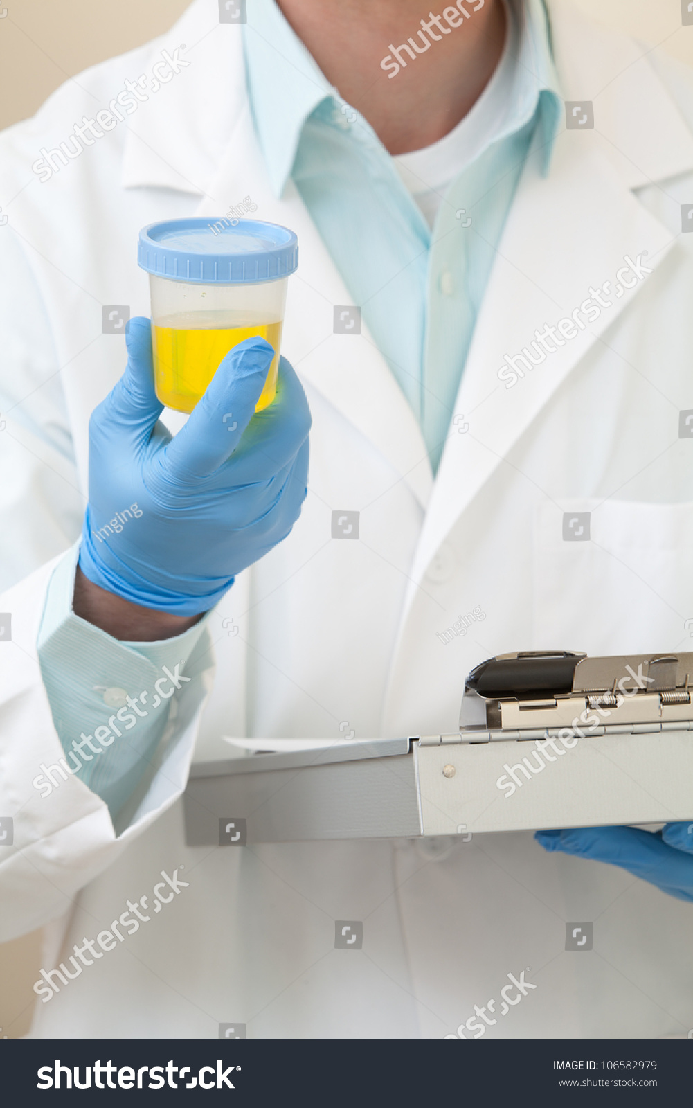 A Doctor Holding A Urine Sample Stock Photo 106582979 ...