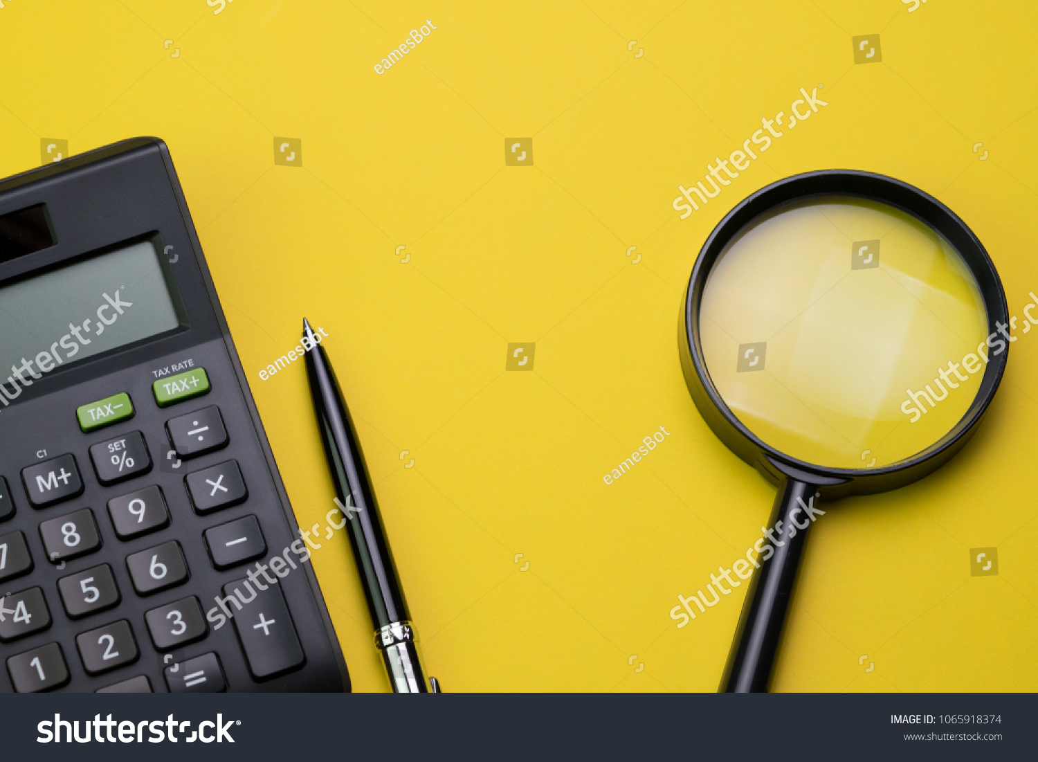 Expense, cost, budget, tax or investment calculation, flat lay or top view of black pen with calculator and magnifying glass on vivid yellow background table with copy space.