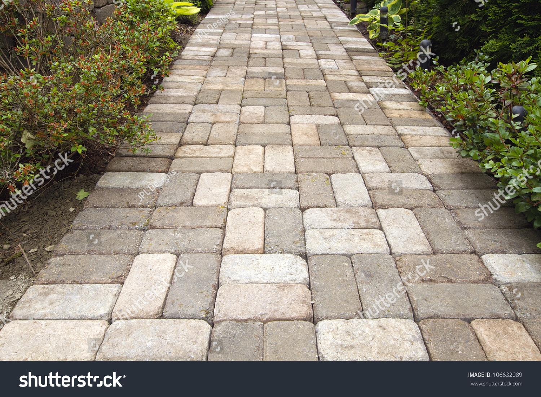 Garden brick pavers path walkway basket stock photo for Garden path designs pavers