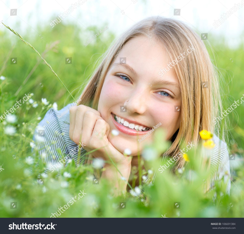Beautiful Teenage Girl Lying On Meadow Stock Photo