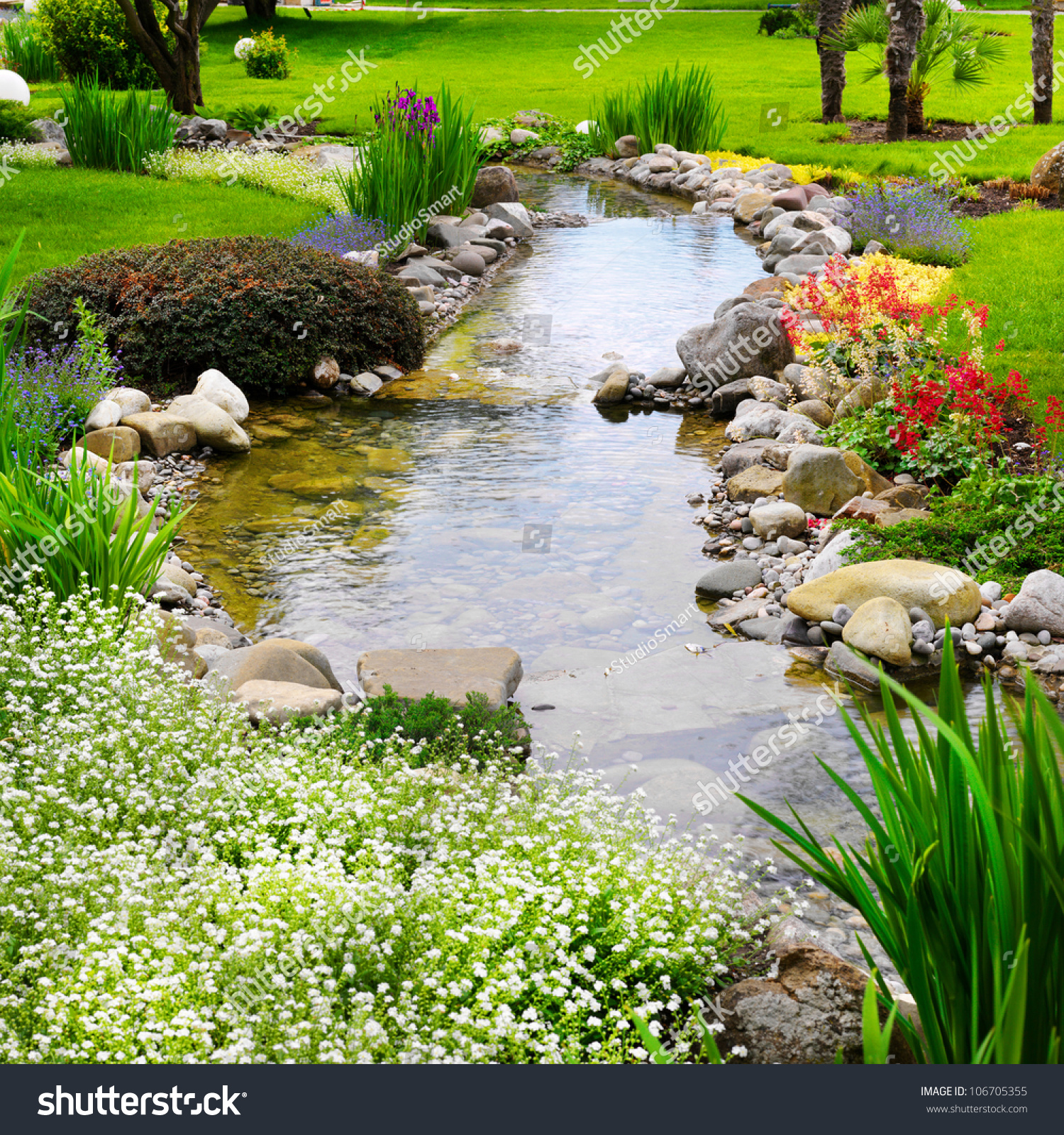 Backyard Flower Garden: Spring Flowers In The Asian Garden With A Pond Stock Photo