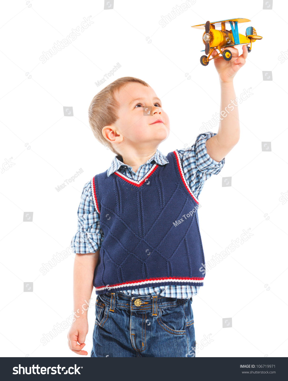 28aaeda9a94 Cute little boy playing with a toy airplane. Isolated on white background