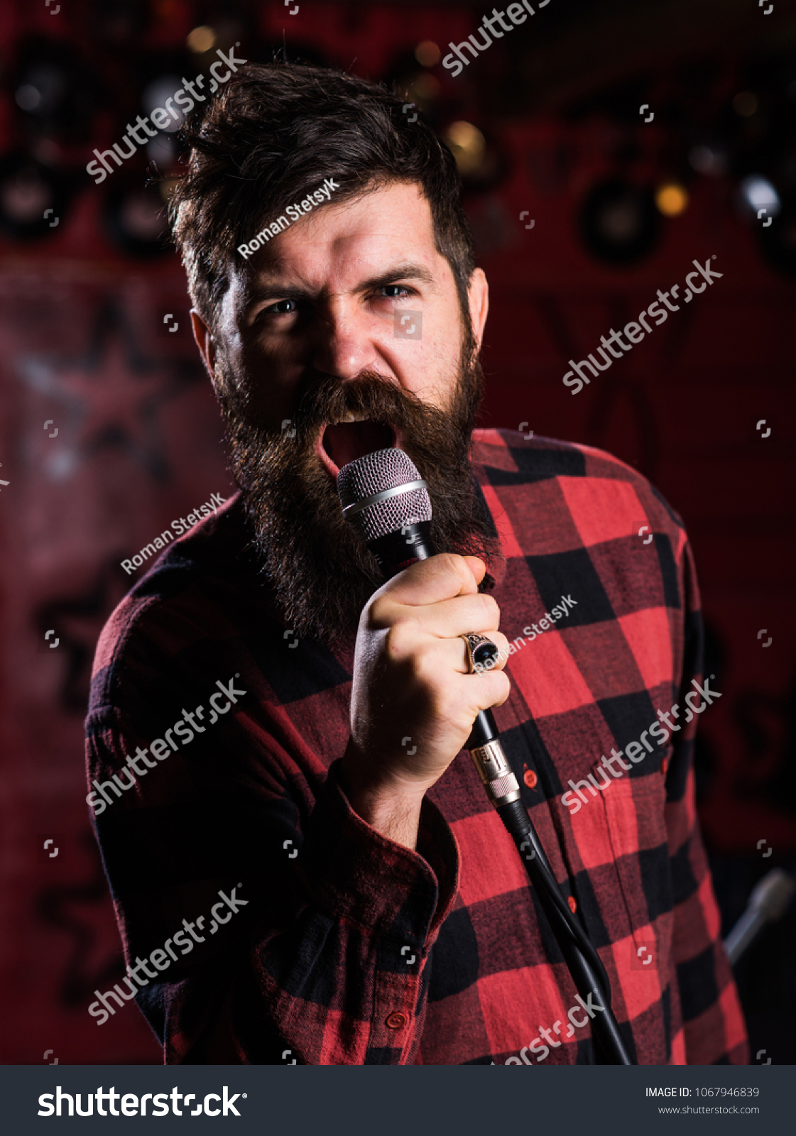 Man Agressive Face Holds Microphone Singing Stock Photo (Edit Now