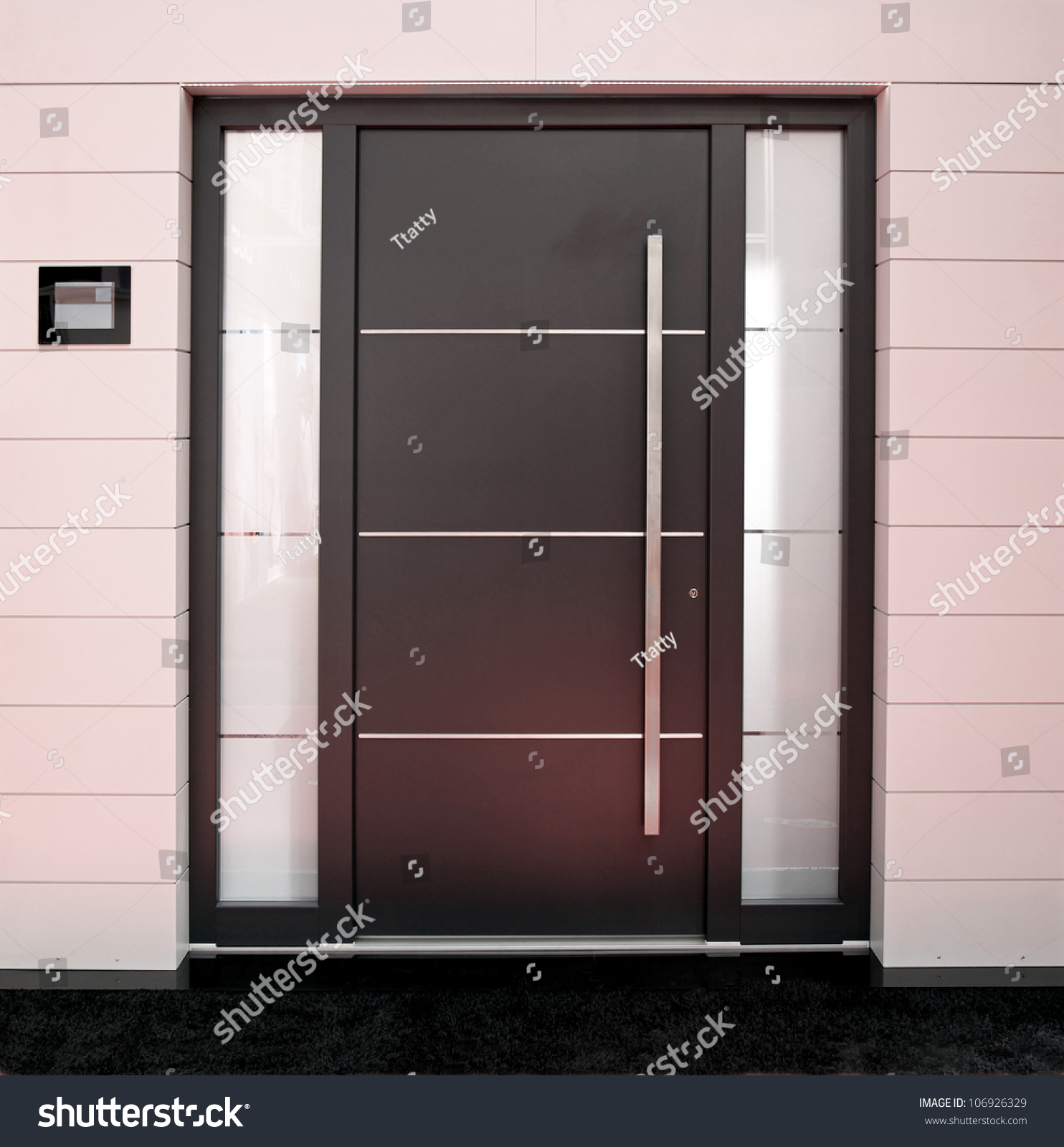Big outside entrance door with silver details stockfoto for Big entrance door